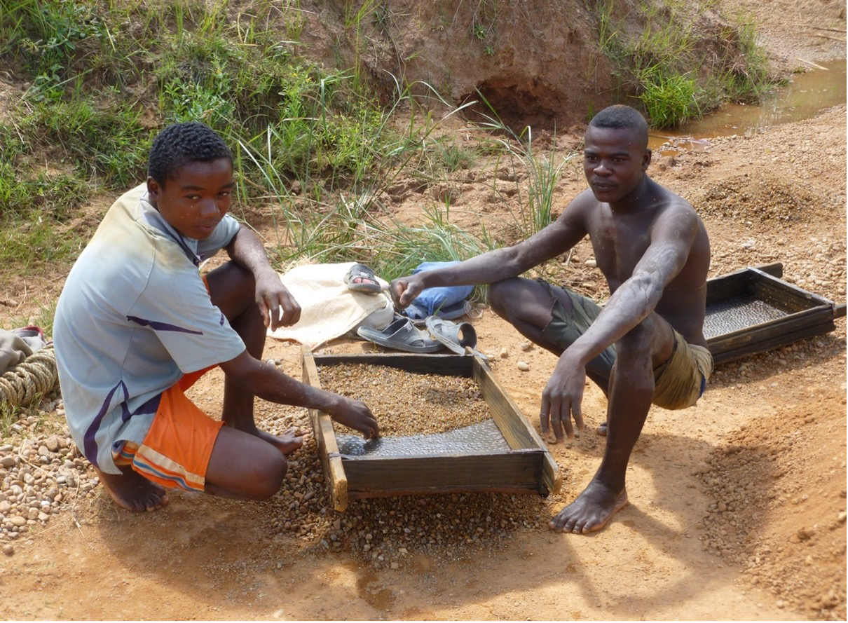 Sieving gravels to reveal and pick coloured gemstones from an alluvial deposit. Photo credit: Swarovski.