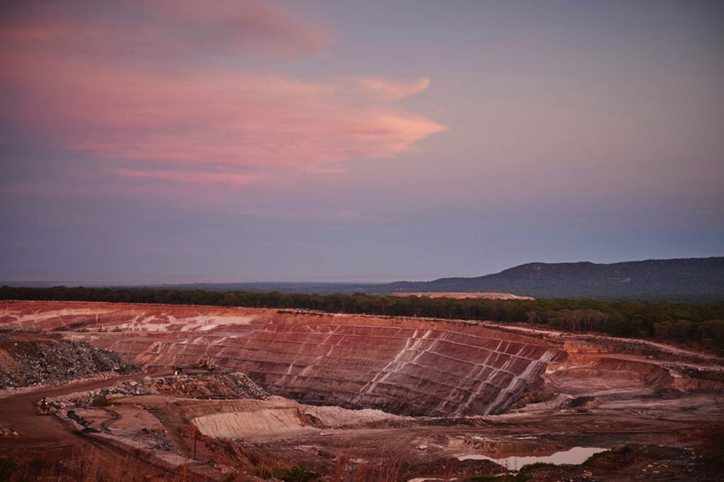 An open pit emerald mine at Kagem, Zambia, an example of large-scale mining. Photo credit: Gemfields